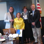 Left to Right: Rotary Past President Sue Manning, Charles Schuller, Mike Anderson. Looking on: Frank Wever, a 54-year member of the Club.