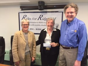 Bill Maxwell delivers $15,00 grant check to Rides for Ridgefield to fund specialized scheduling software.