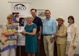 "Sue Manning, Rotary Club Chair of Grant Committee, delivers $500 grant check to TBICO (The Bridge to Independence & Career Opportunities) to help fund ""Better Skills, Better Jobs, Better Lives""program."